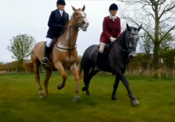 Katie (left) riding her horse in the hunt.